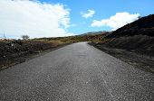 stock photo of canary-islands  - Long Empty Desert Asphalt Road in El Hierro Canary Islands Spain - JPG