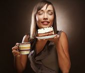 image of pie-in-face  - beautiful smiling young woman with a cake and coffee - JPG