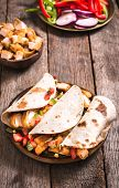 stock photo of sandwich wrap  - Wrap sandwiches with fried chicken meat and vegetables - JPG