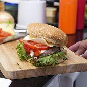 stock photo of hamburger  - Close up Hamburger on wooden broad  - JPG