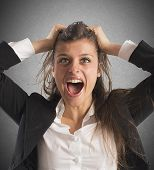 pic of scream  - Furious businesswoman stressed out from work screams - JPG
