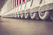 image of trolley  - Close up trolleys luggage in a row in airport retro filter effect  - JPG