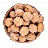 stock photo of walnut  - Whole walnuts in a wooden bowl isolated on a white background - JPG