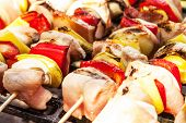 stock photo of grill  - Grilling shashlik on barbecue grill - JPG