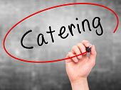 stock photo of catering  - Man Hand writing Catering with marker on transparent wipe board - JPG