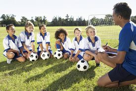 picture of football pitch  - Group Of Children In Soccer Team Having Training With Coach - JPG