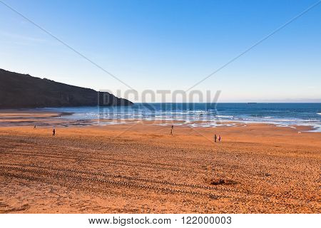 The Bay of Biscay near Bilbao Spain in January: long beach and ocean before sunset time
