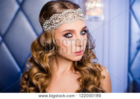 Beautiful blonde with curly hairstyle and white openwork lace bandage