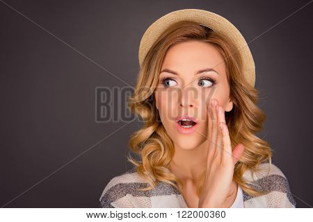 Portrait Of Beautiful Gossip In Hat Holding Hand Near Face And Telling Secret