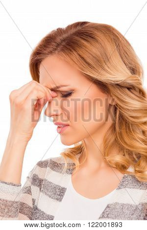 Attractive young woman suffering of strong headache