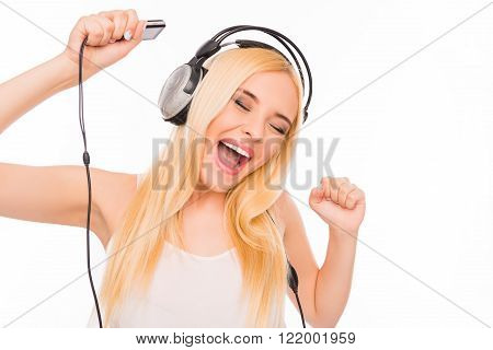 Cheerful Lady With Mp3 And Headphones Listening Music And Dancing