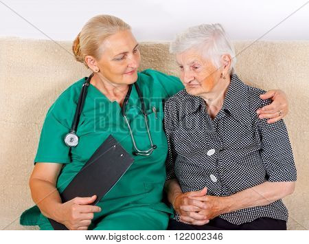 Picture of a senior woman talking with her caregiver