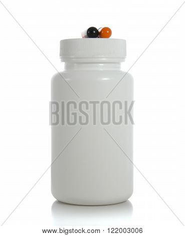 two pills of a black and orange colors with white jar on white background