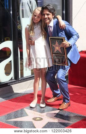 LOS ANGELES - MAR 10: Mexican actor Loreto Peralta, Eugenio Derbez at a ceremony where Eugenio Derbez is honored with a star on the Hollywood Walk of Fame on March 10, 2016 in Los Angeles, California