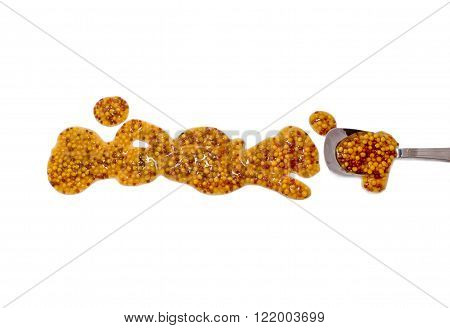 splashes, droplets and spilled mustard with a spoon. Blots of  french dijon rough mustard and spoon dipped in sauce. isolated on white background. flat lay, top view