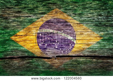 Brazil flag painted on the old cracked wood with worn-out paint. Grunge look.