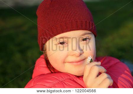 Little girl enjoy with flower in the park