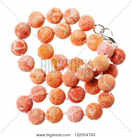 Tangled Necklace From Orange Coral Beads Isolated