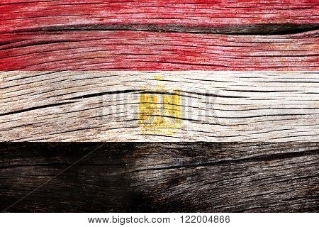 Egypt flag painted on the old cracked wood with worn-out paint. Grunge look.