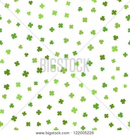 Abstract green seamless pattern for St. Patricks day from the clover leaves on white background. Design for banner, card, invitation, postcard, textile, fabric, wrapping paper. Vector illustration.
