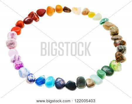 round line from from natural mineral tumbled gem stones isolated on white background