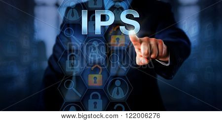 Corporate systems administrator is pushing IPS on a touch screen. Information technology and computer security concept for an intrusion prevention system that blocks malicious network connections.