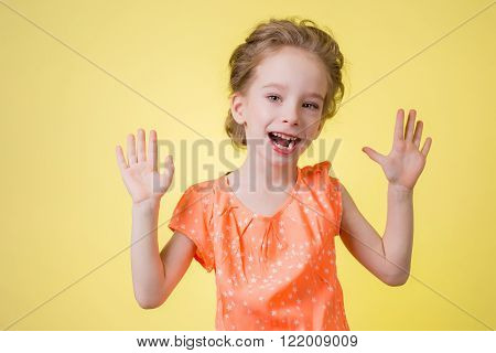 bright picture of happy teenage girl showing her palms.