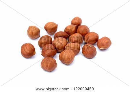 Pile of healthy hazel nuts isolated on white background