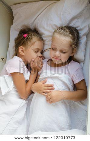 Two Girls Pretending That Sleep On The Bottom Shelf In A Train