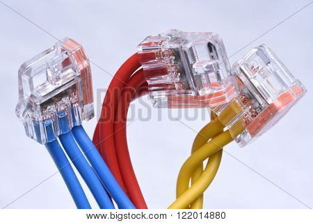 Colorful electrical cables with connectors on metal grey background