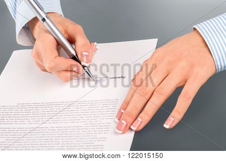 Woman signing rent contract. Female employee signs rent contract. Beneficial for both sides. Simple clear agreement.