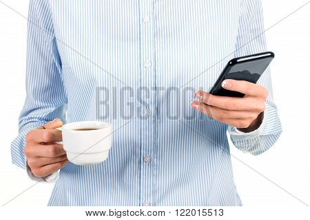 Woman's tea cup and cellphone. Lady holding smartphone and cup. Reading fresh news at work. I'm glad it's fully charged.