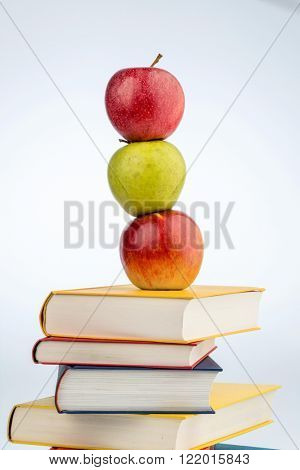 apple on a pile of books