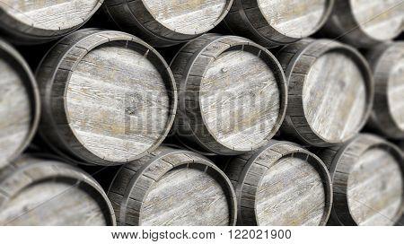 Grey wooden barrels of wine in rows