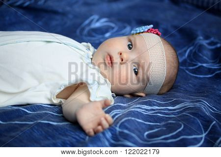 3-months Baby Girl Lying On A Coverlet