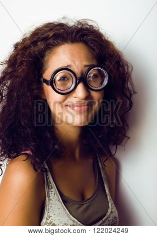 bookworm, cute young woman in glasses, curly hair, teenage education concept