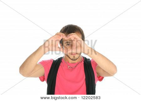 Young man shows heart symbol