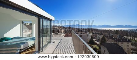 beautiful view of the Swiss Alps, by a terrace of a duplex