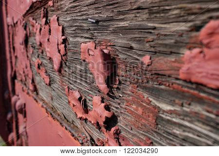 Red Peeling Paint on Wooden Rail Car
