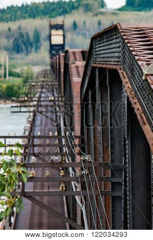 Rusty Railway Bridge Over River with Telegraph Line ** Note: Visible grain at 100%, best at smaller sizes