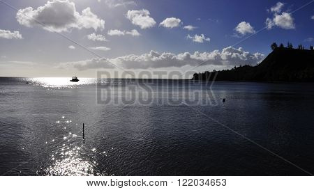 A fishing boat in the middle of Cetti Bay Guam.