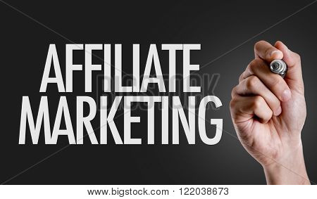 Hand writing the text: Affiliate Marketing