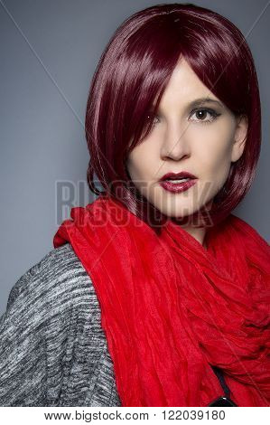 Woman with red hair wearing a red scarf around her neck