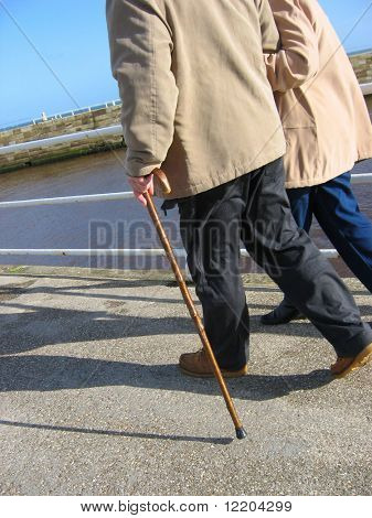 Elderly couple strolling on Whitby pier