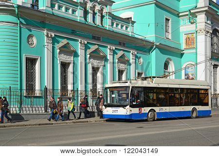 Moscow, Russia - March 14, 2016. Trolley bus at a  bus stop in front of Cathedral  Epiphany at  street Spartacus