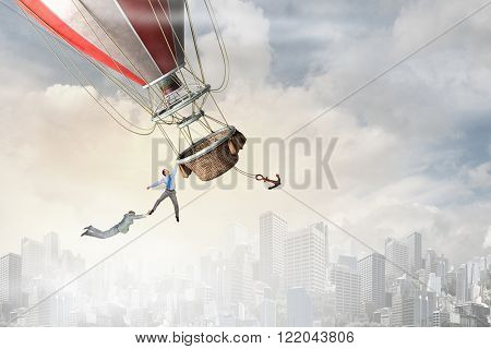 Woman and man flying on aerostat