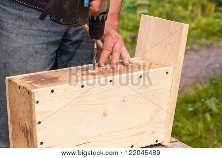 Carpenter Works With Drill, Close Up Photo