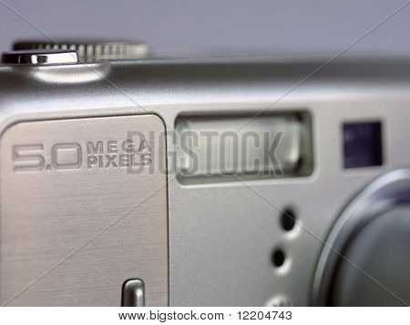 Digital camera - focused on the mega-pixel sign.