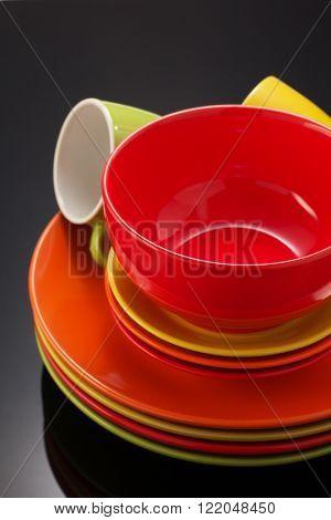 set of dishware on black background