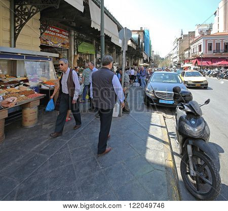 ATHENS GREECE - MAY 05: Shoppers at Central Market in Athens on MAY 05 2015. People Walking Near The Dimotiki Agora Fish Market in Athens Greece.